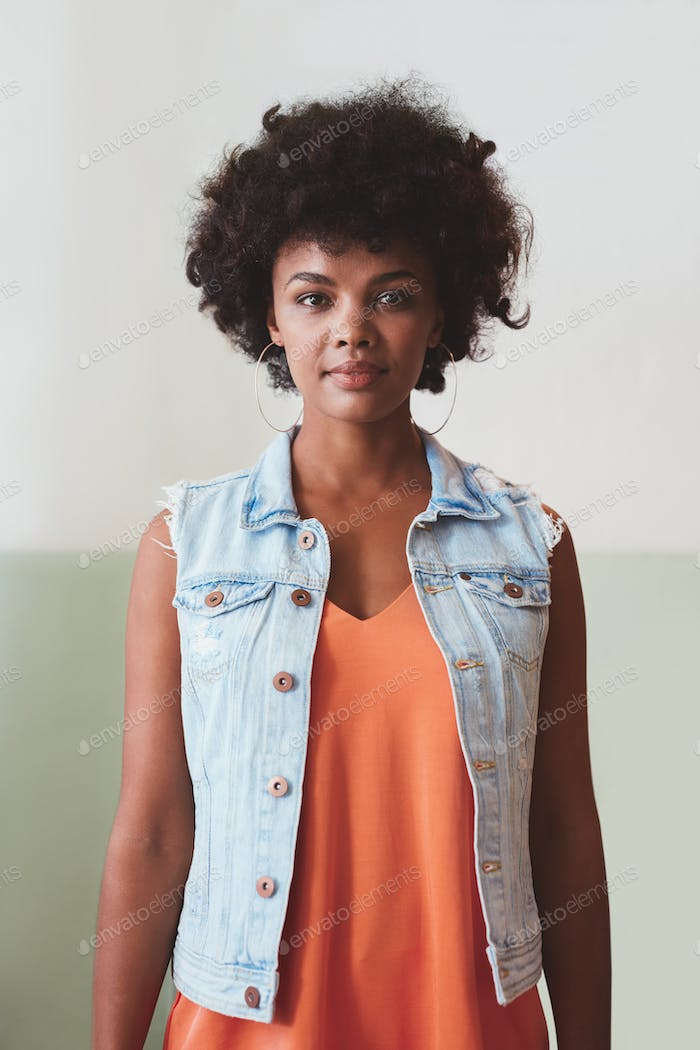 African female model looking confident in smart casuals