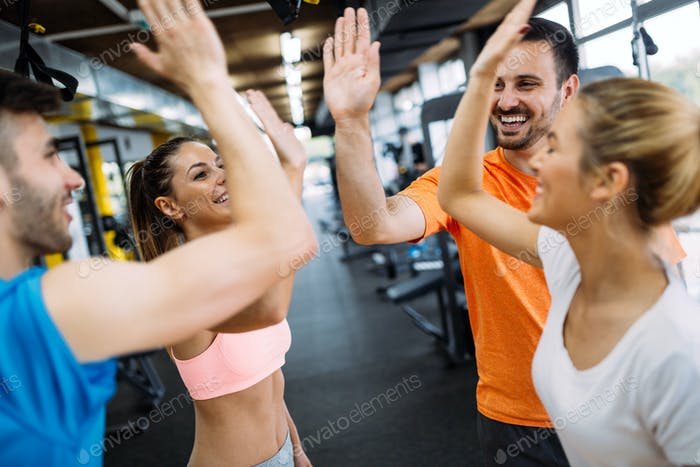 Happy fitness class giving high-five after completing exercise session
