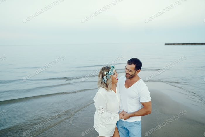 elegant adult couple near sea