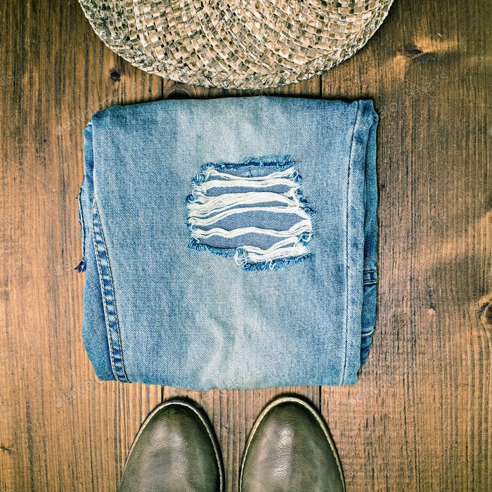 Shoes Jeans and Hat on Wooden Floor