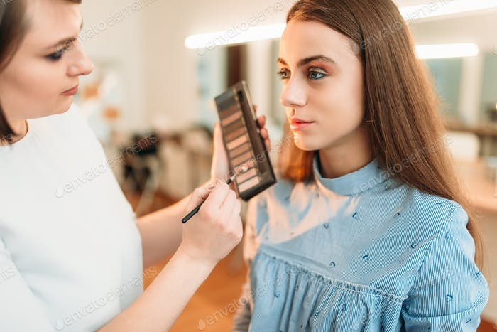 Professional beautician work with woman face
