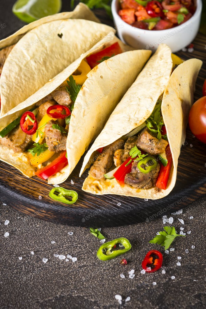 Mexican pork tacos with vegetables and salsa
