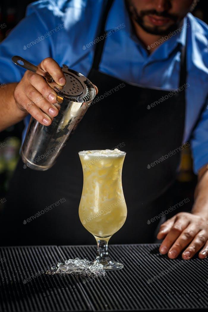 Bartender preparing pina colada cocktail