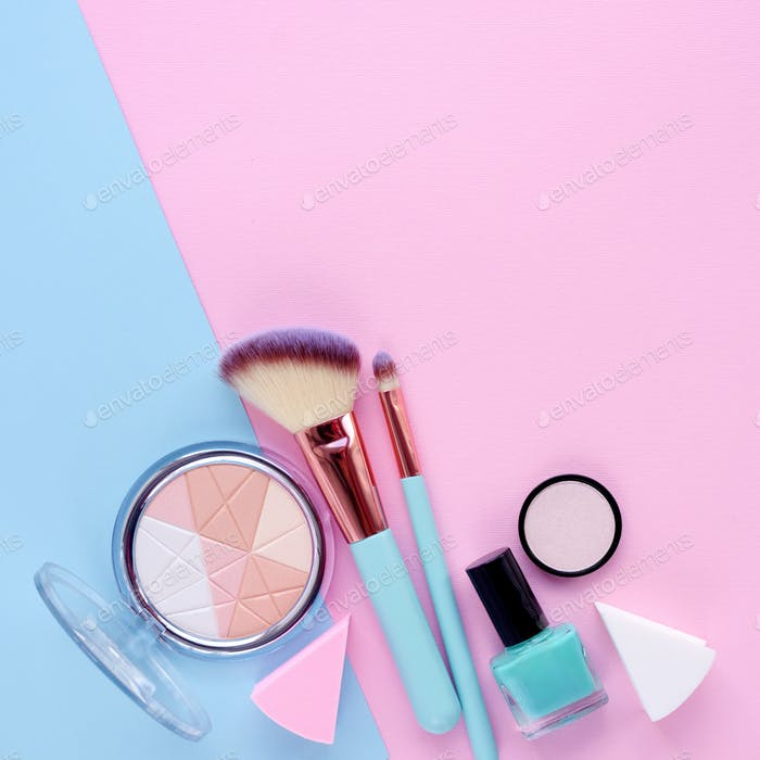 Makeup brush and decorative cosmetics on color background, with