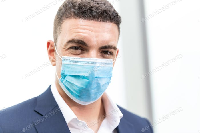 Portrait of man wearing protective mask