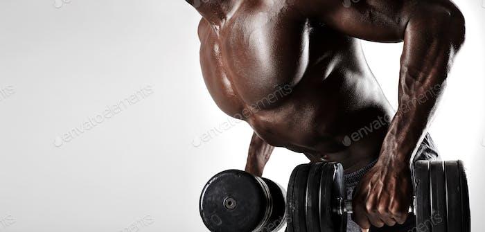 Bodybuilder exercising with dumbbells