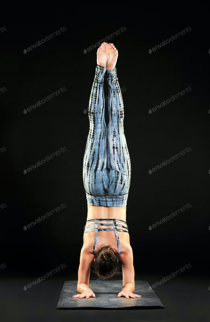Woman demonstrating a forearm stand or pincha pose