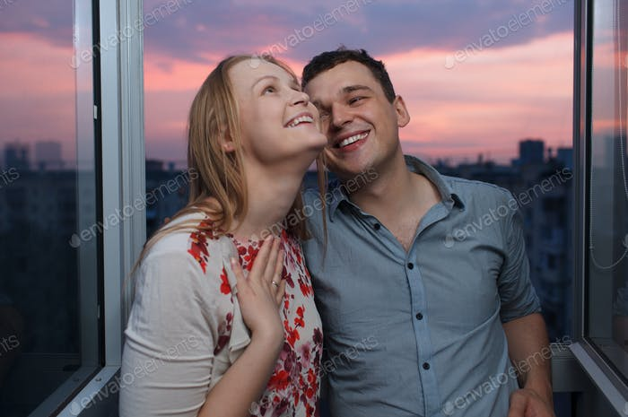 Young happy couple on the balcony
