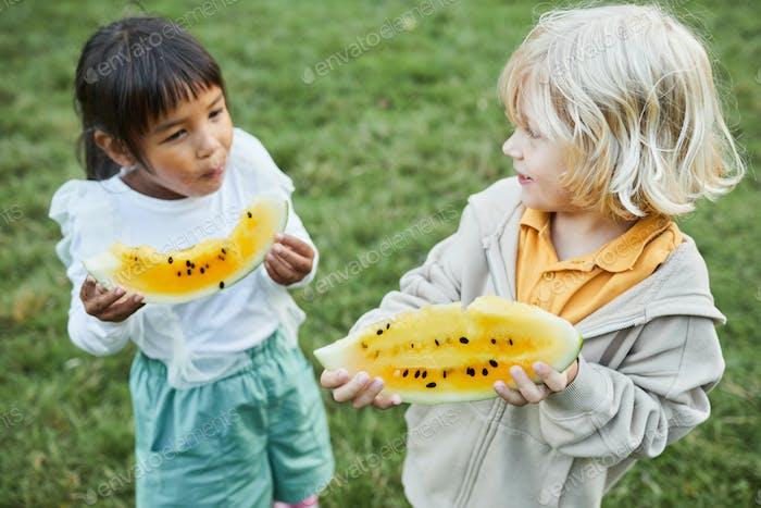 Kids Eating Watermelon at Picnic
