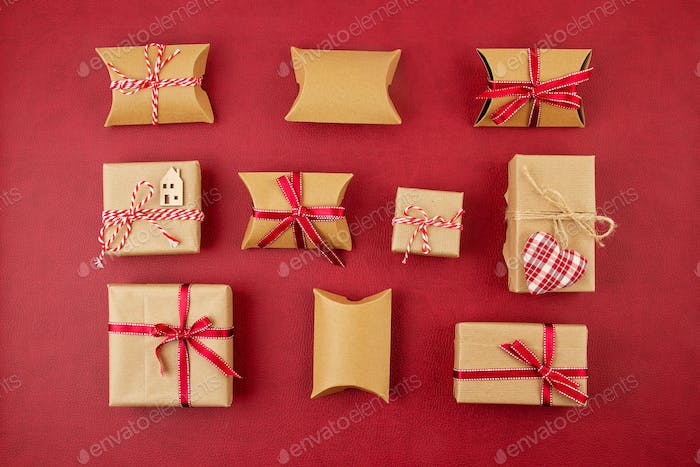 Festive christmas background with plastic free, cardboard gift boxes made of recycled paper