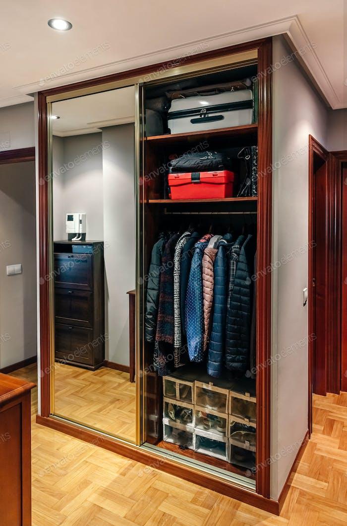 Built-in wardrobe open with mirror doors