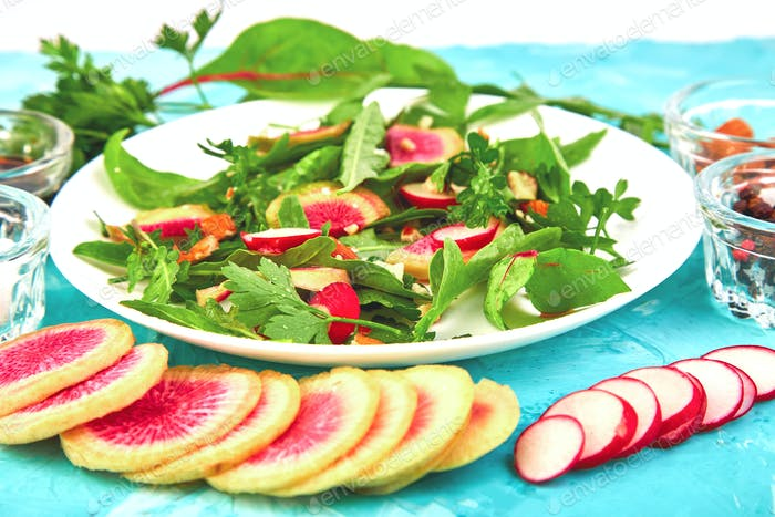 Salad in white plate around Ingredient mix leaf radish