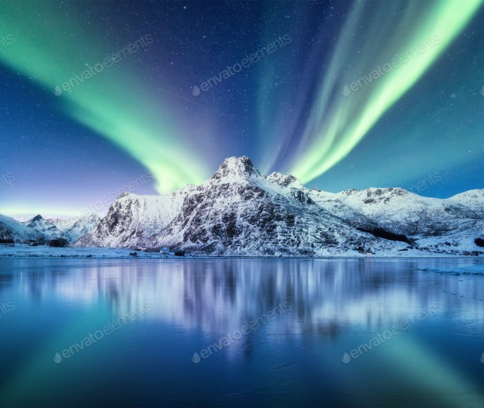 Aurora Borealis, Lofoten islands, Norway. Nothern light and reflection on the lake surface.