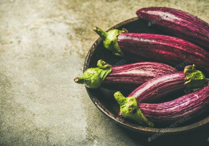 Fresh raw Fall harvest purple eggplants, copy space