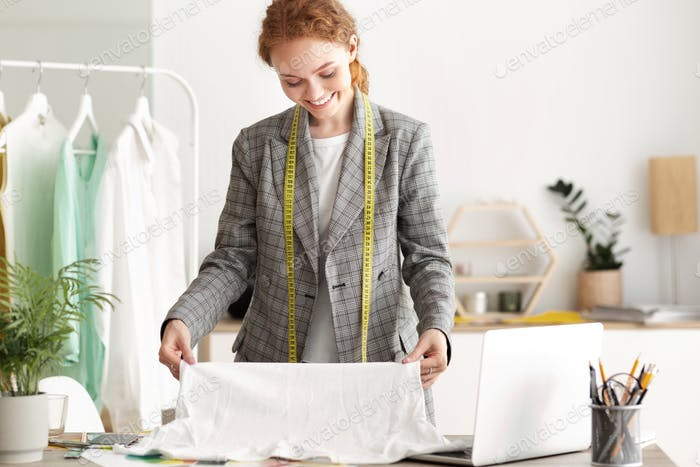 Happy Tailor Girl Working On A New Garment
