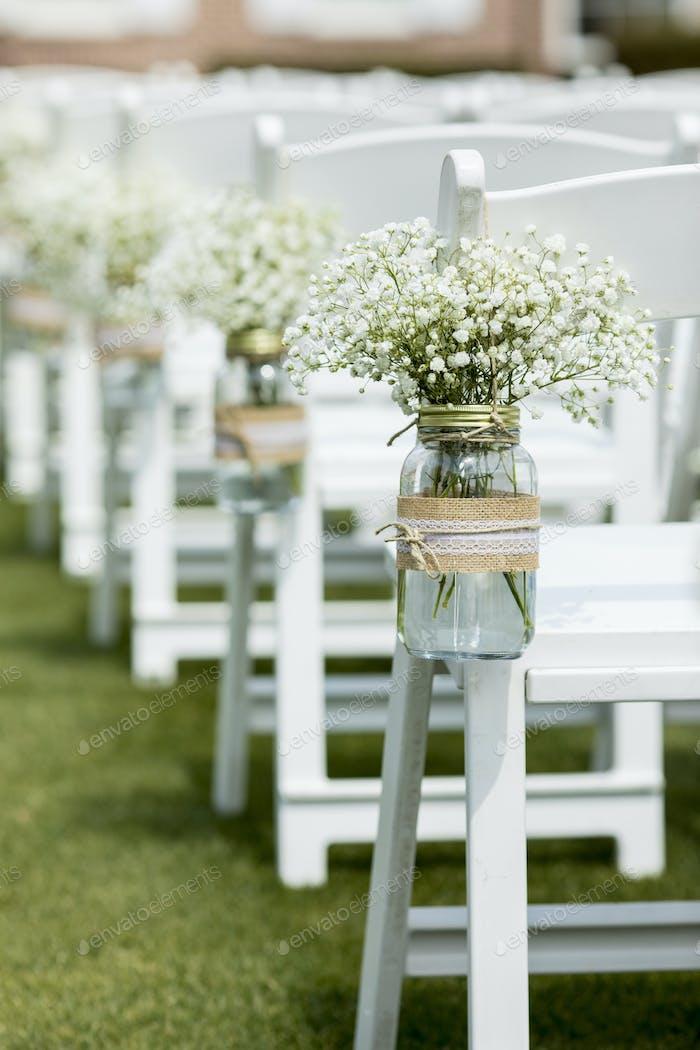 mason jar and flowers at wedding