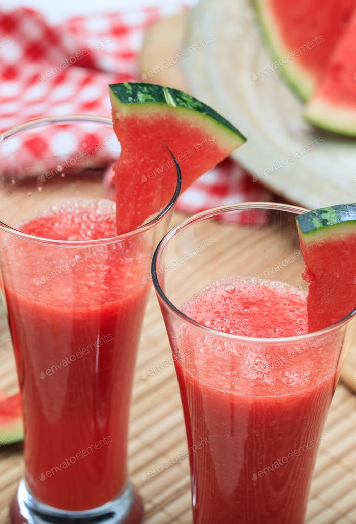 Watermelon juice glasses closeup view, fresh healthy refreshment