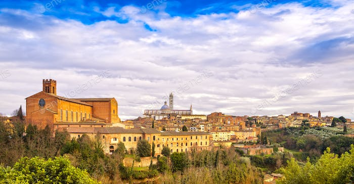 Siena sunset panoramic skyline. San Domenico and Duomo cathedral