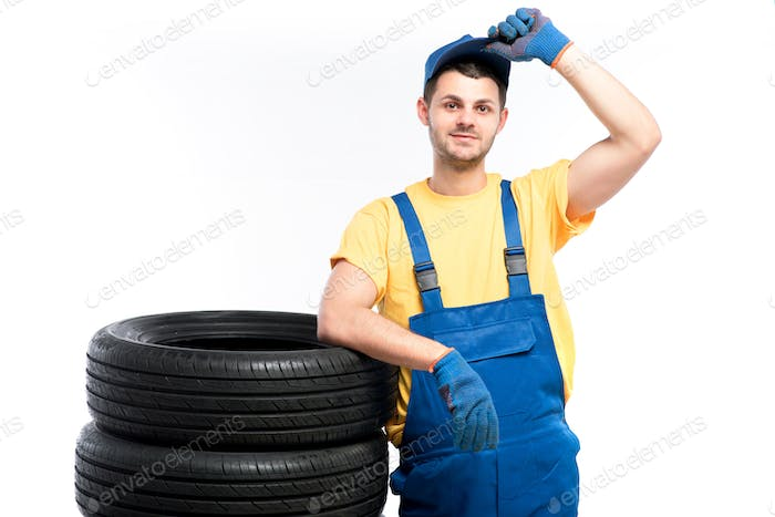 Serviceman sitting on tires, white background