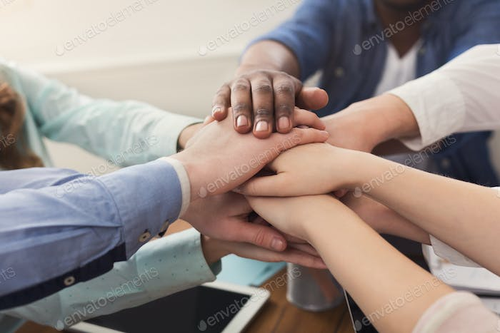 Teamwork and teambuilding, people connect hands