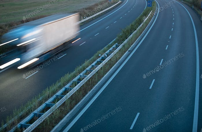 highway traffic - motion blurred truck on a highway/motorway/spe