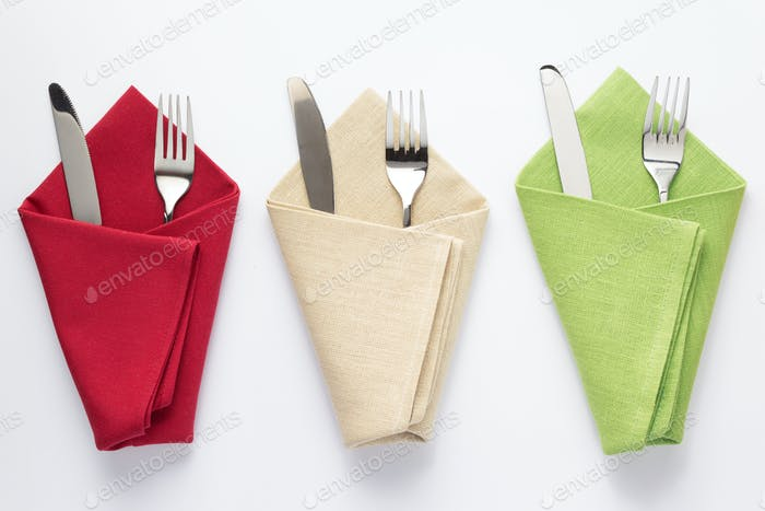 knife and fork in folded napkin