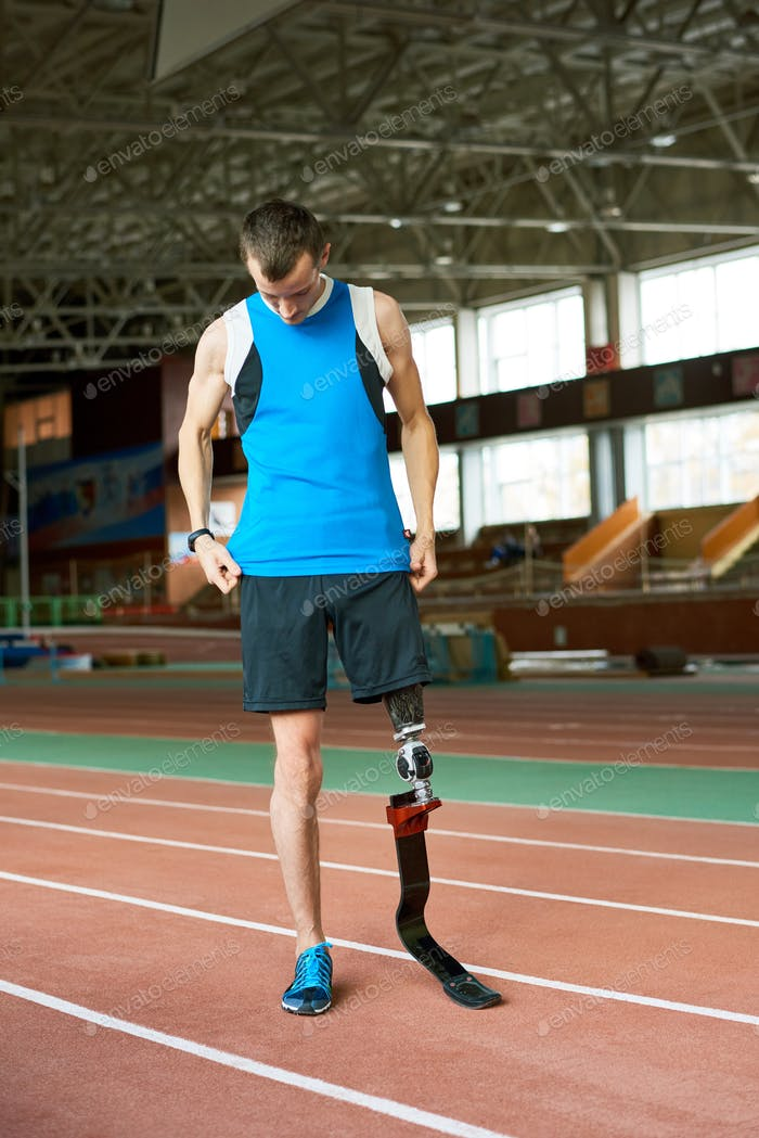 Handicapped Runner on Track in Stadium