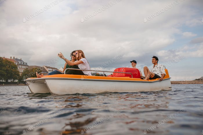 Group of people in boat taking selfie