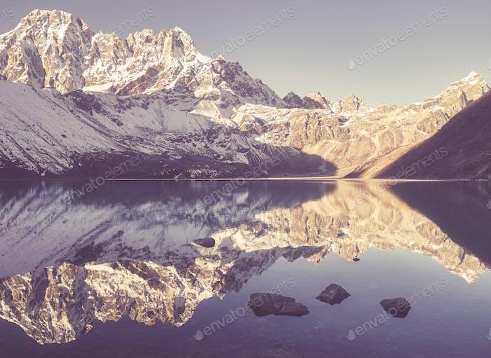 mountains reflected in Gokyo Lake, Nepal.