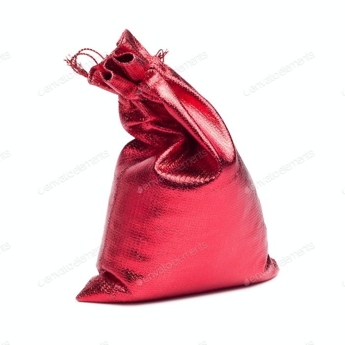 Red Christmas Bag With Present Over White