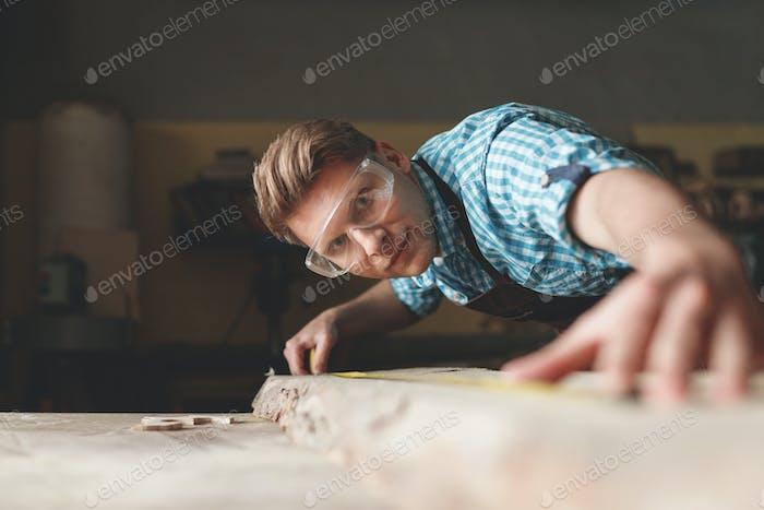 Young carpenter at work