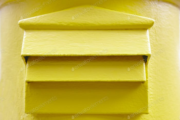 Classic yellow mail box detail. Postbox. Postal service. Traditional communication