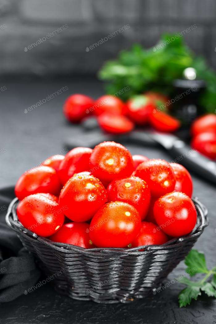 Tomatoes. Fresh tomatoes in basket on table