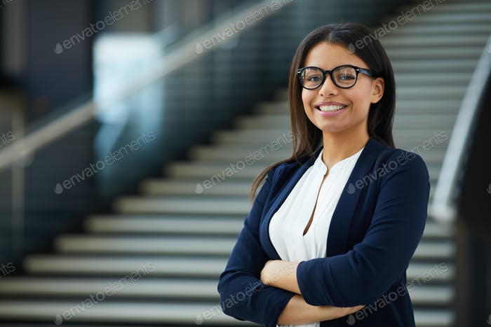 Smiling smart lady working in prosperous company