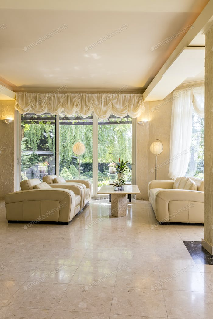 Beige living room in luxurious style