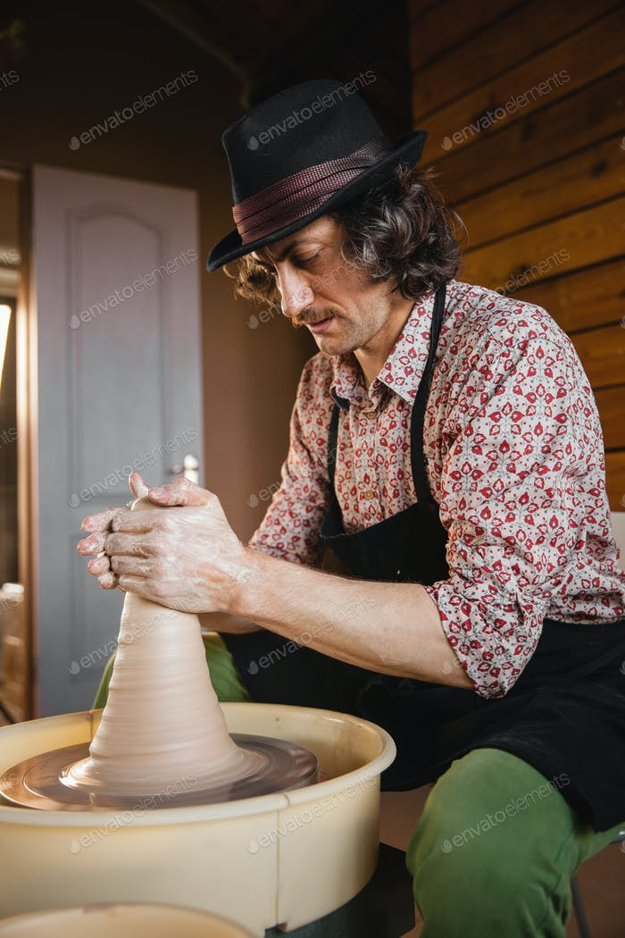 Potter master creating new ceramic jug