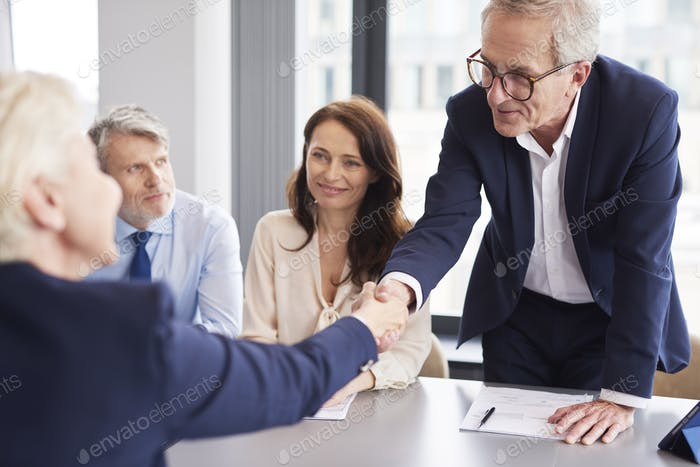 Good deal between business partners during business meeting