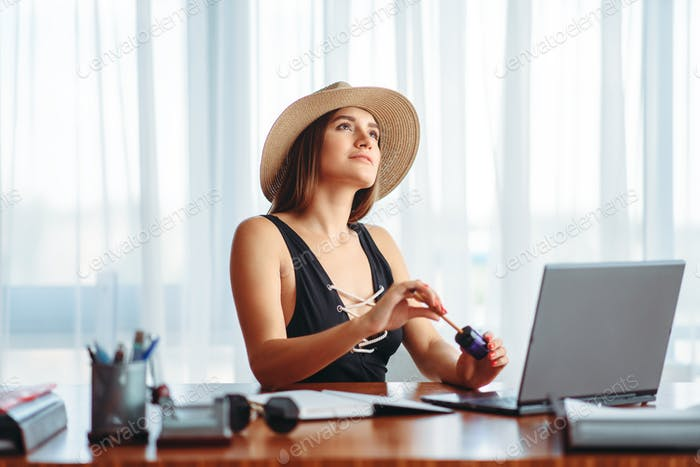 Woman works on laptop, and dreaming about vacation