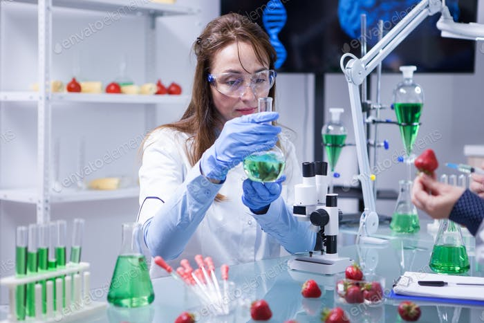 Middle age scientist woman wearing protection glasses in a research laboratory