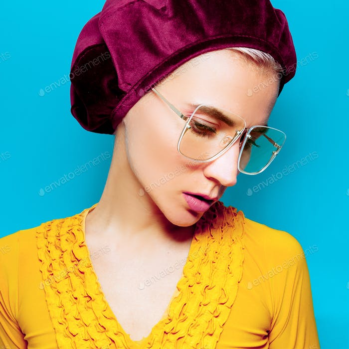 Model in fashion accessory beret and glasses. Retro style
