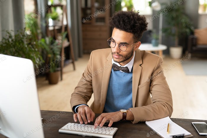 Afro American businessman typing on computer
