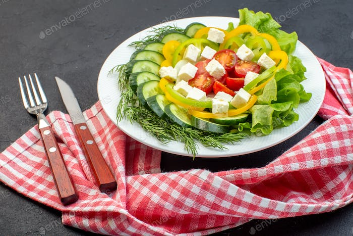 front view vegetable salad consists of sliced tomatoes cucumbers pepper and cheese on dark