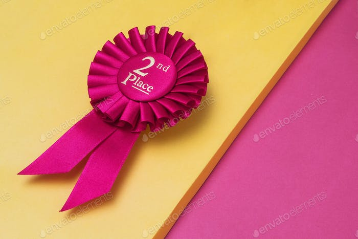 Rosette second place for the achievement and success of the winner on illuminating background