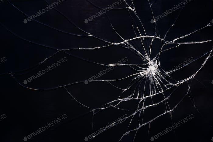 Gebrochene Glasstruktur mit Rissen.