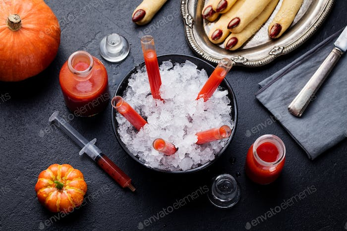 Bloody Mary Cocktail in Glass Tubes with Witch's Fingers Cookies for Halloween Party Celebration.
