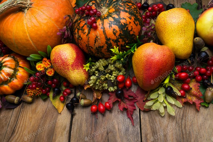 Thanksgiving arrangement with pumpkin and pear