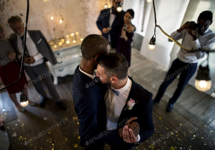 Newlywed Gay Couple Dancing on Wedding Celebration