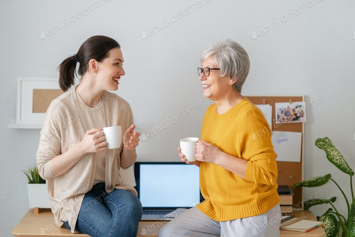 women are chatting and laughing in the office