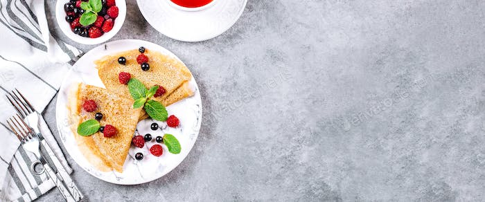 Delicious Crepes Breakfast. Orthodox Holiday Maslenitsa. Pancakes with berry currant, raspberry