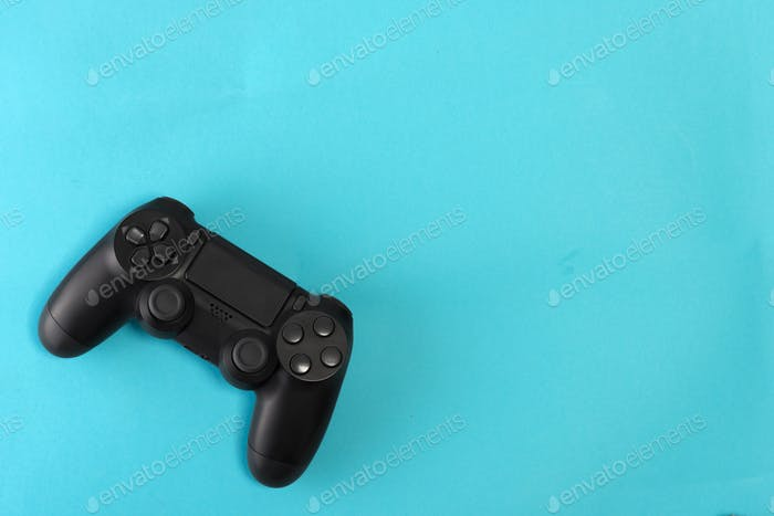 game controller on blue background studio shot